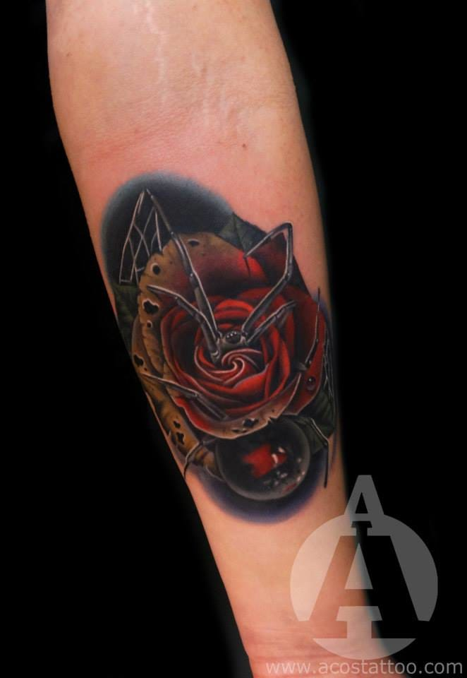 Rose tattoo combined with a spider