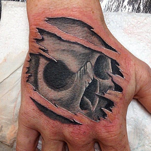 Cool hand tattoo by Jess Tattoos.