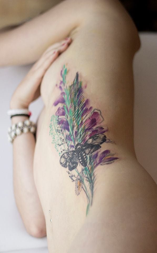 Delicate flower and bug tattoo