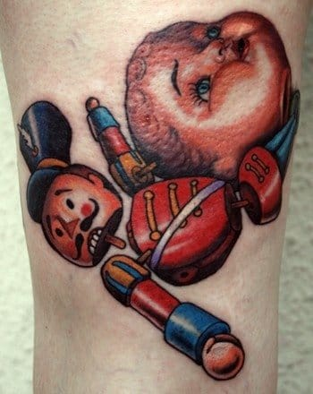 Broken toy tattoo by Shawn Barber