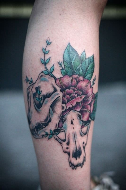 Dog skull tattoo by Alice Carrier