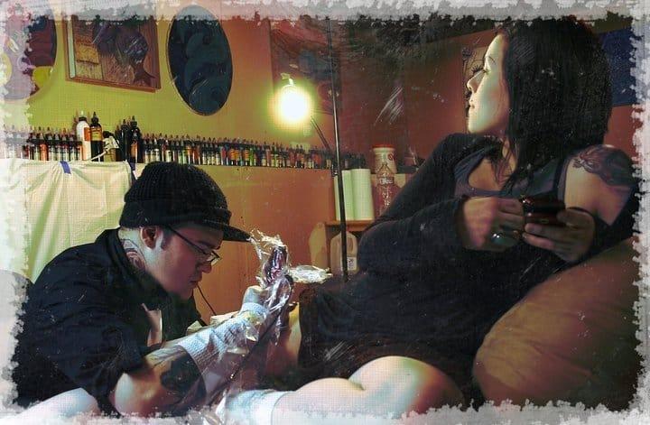 Tattoo artist in action