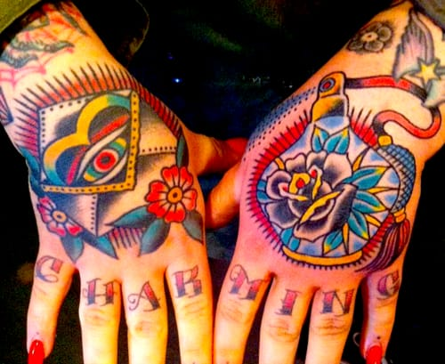 These new school hand tattoos are looking tight. Artist unknown.