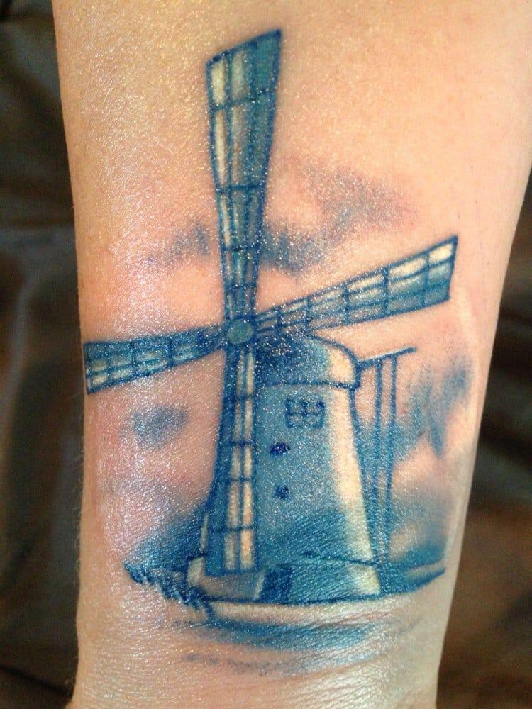 Artistic Windmill Tattoo