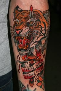 tiger tattoo in neo-traditional style by Stefan Johnsson, strike hard - strike first