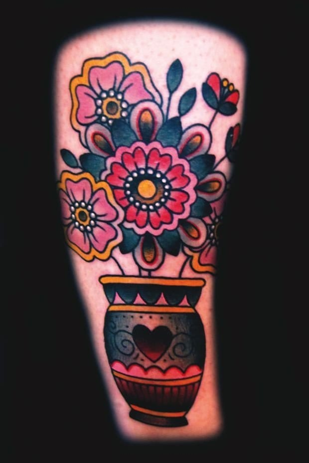 Ashley Love did this colorful thigh piece!!