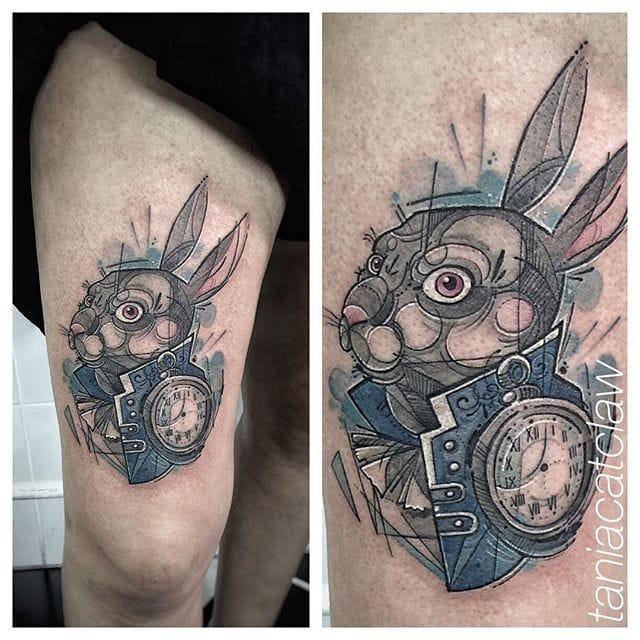 Great Alice in Wonderland tattoo.