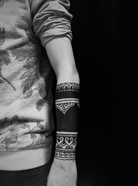 Blackwork arm tattoo by mantratwix / Instagram