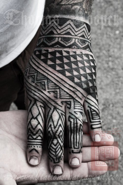 Blackwork hand tattoo by Thomas Hooper