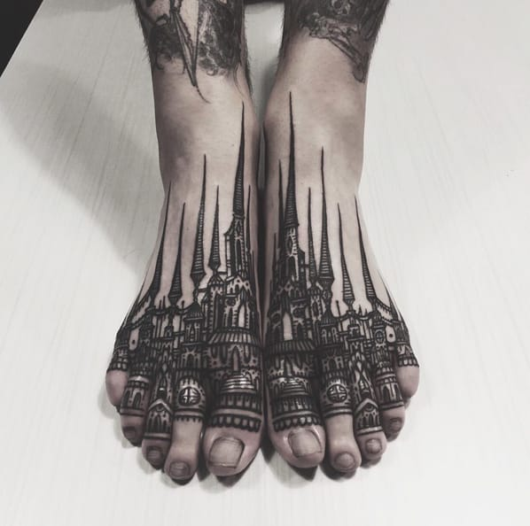 Blackwork foot tattoo by Thieves of Tower