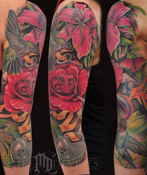 Floral tattoo sleeve by Mike Devries