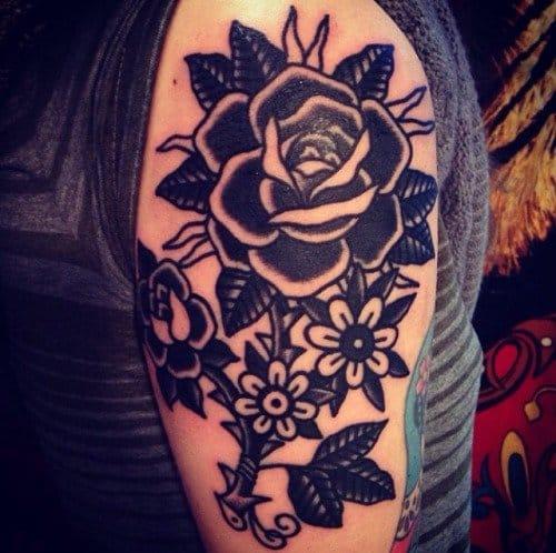 Intense black rose tattoo by Hillary Fisher-White