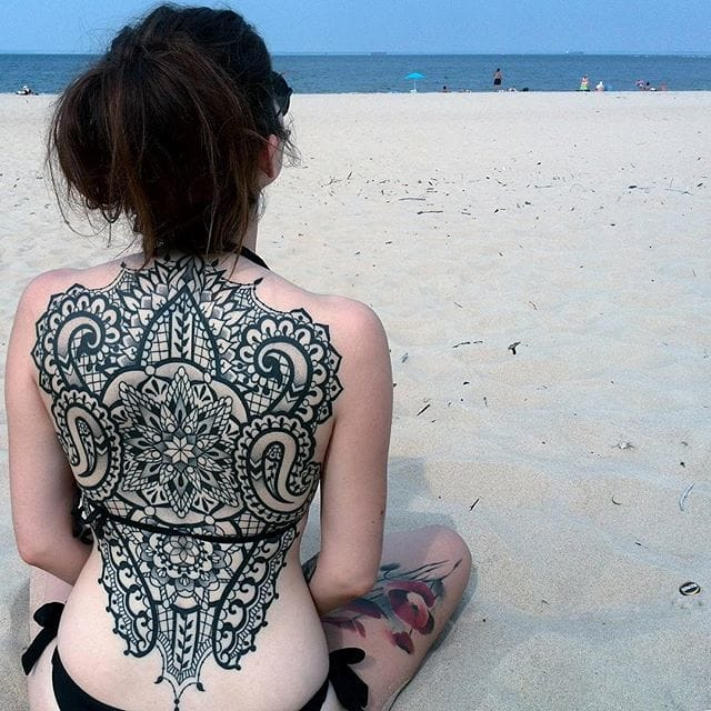 Gorgeous backpiece mixing neo tribal and lace art...