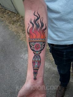 Lovely Torch Tattoo by Justin Dion