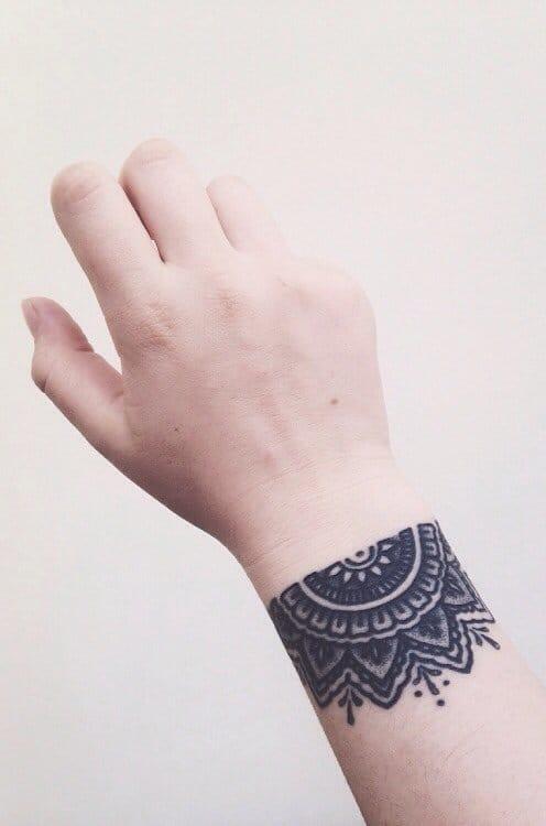 Half Mandalas can be used as a bracelet tattoo.