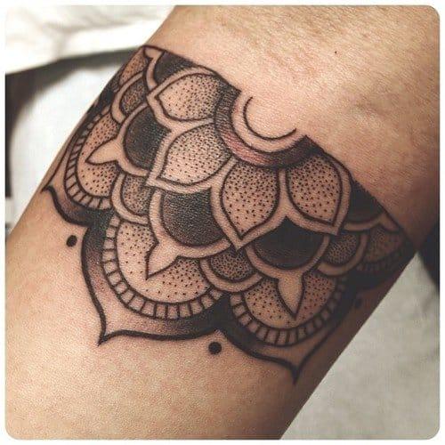 Half mandala tattoo