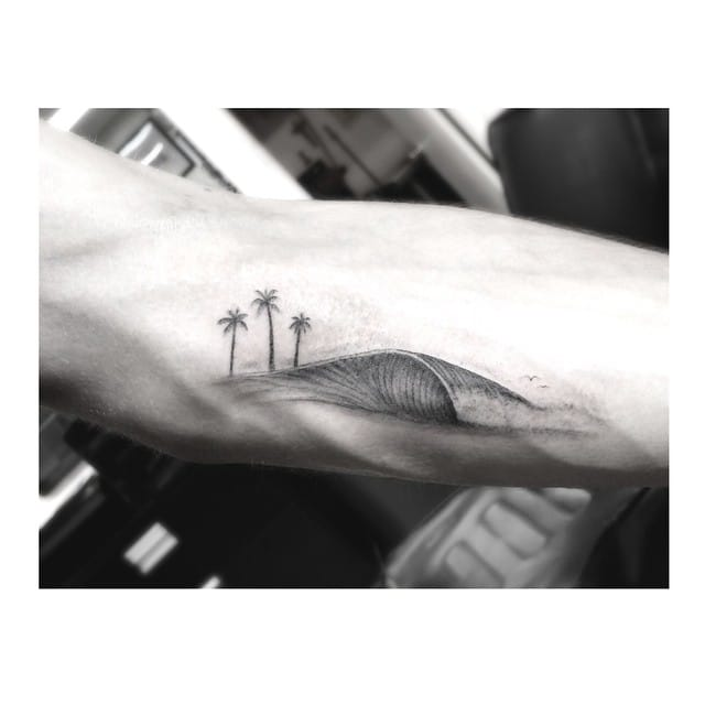 palm tree and wave tattoo