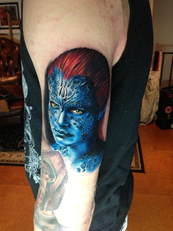 Mystique Supervillain tattoo by Mick Squires
