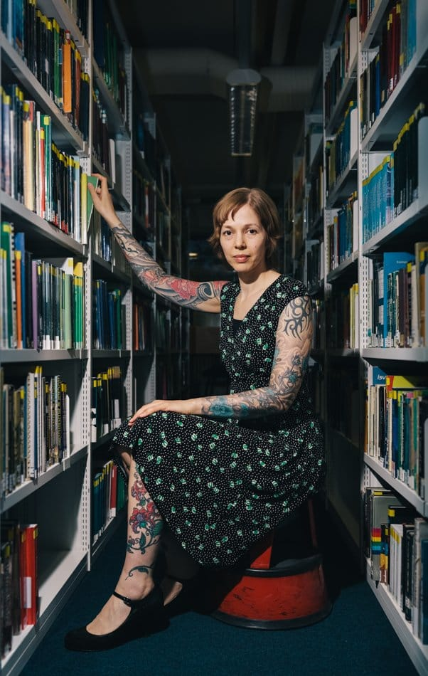This heavily tattooed librarian can advise you great literature. Source: Heather Shuker Photography.
