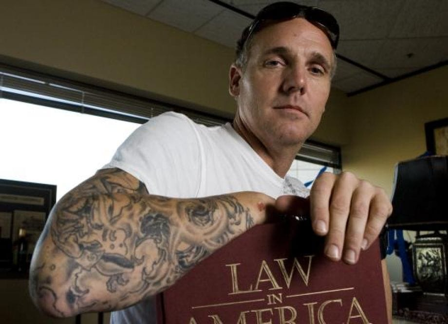 State District Judge Kevin Fine proves tattoos are not illegal.