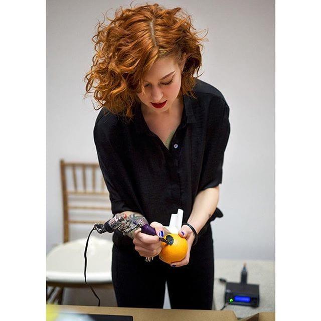 Amanda Wachob tattooing an orange at the Metropolitan Museum of Art