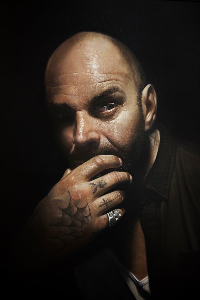 Portrait of a tattooed man.