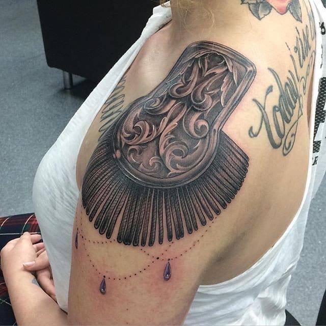 Fancy tattoo by Sean Henry.