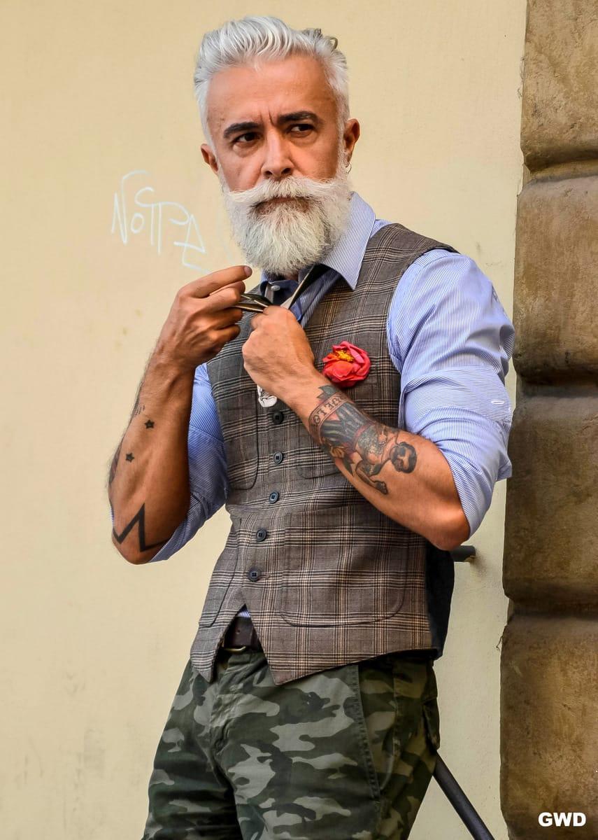 silver-haired, tattooed and bearded Italian man Alessandro Manfredini