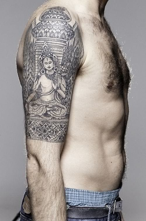 Intricacy in moderation makes a beautiful Buddha tattoo. Love the patterns in this half-sleeve tattoo! #buddha