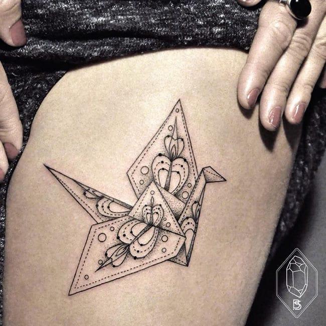Origami tattoos are always poetic.