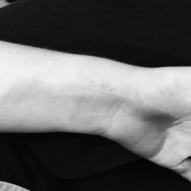 white wave tattoo