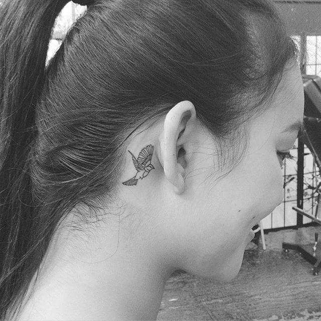 bird tattoo behind the ear