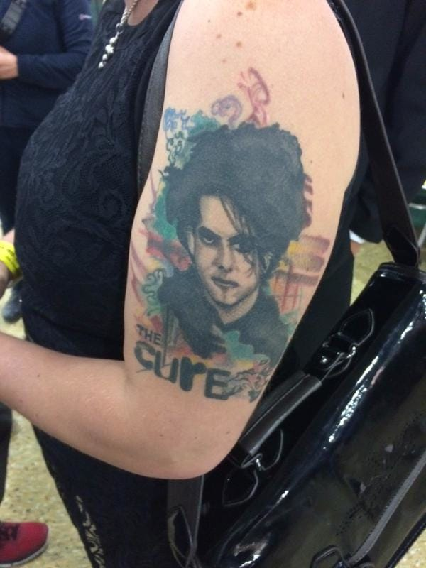 Thats not her only ink, Kerrie Webb also got Robest Smith, from The Cure on her left arm! What an explosive double! via twitter.com/jimwaterson