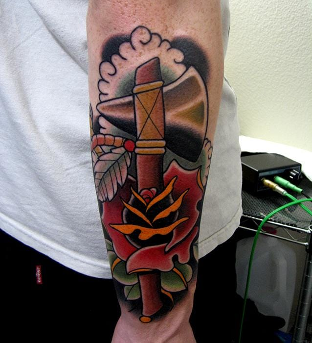 Awesome Tomahawk Rose Tattoo by Jonathan Montalvo