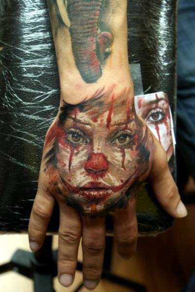 Clown Hand Tattoo by Bloodlines Gallery