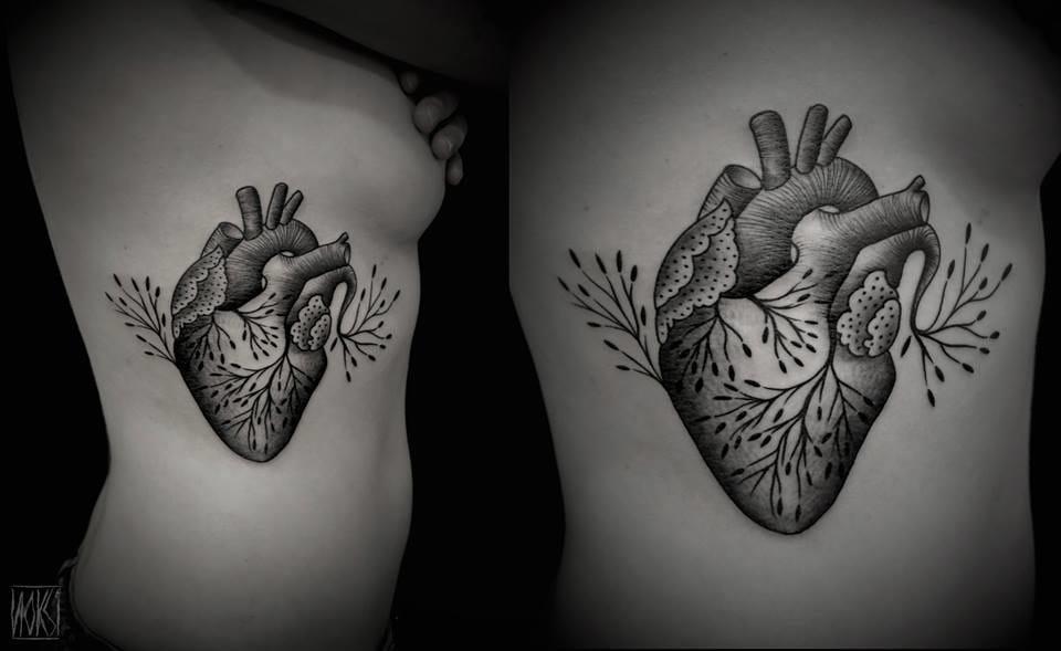 Poetic anatomical heart tattoo.