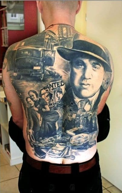 Legendary criminals themed backpiece with the famous couple and Al Capone.