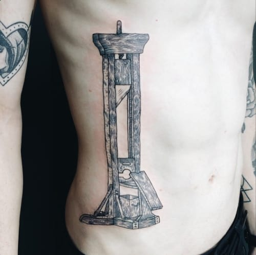 Guillotine Tattoo by Pony Reinhardt