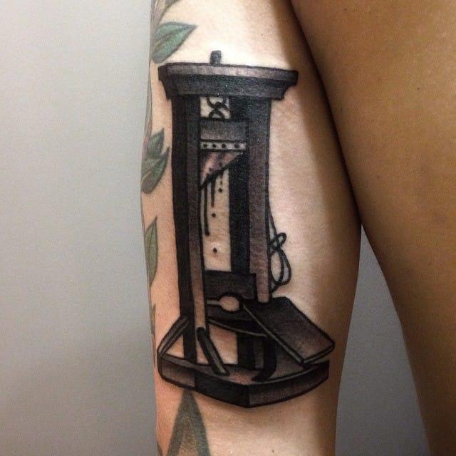 Guillotine tattoo