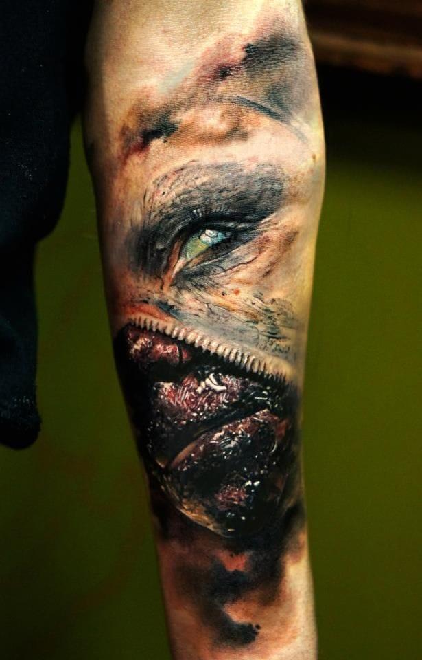 Unzipping evil face by Domantas Parvainis.