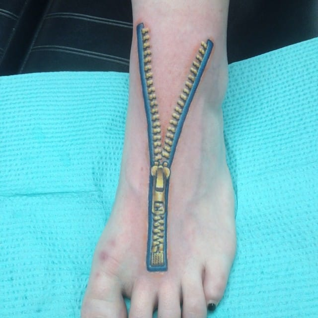 Foot tattoo by Kyle Borchgardt.