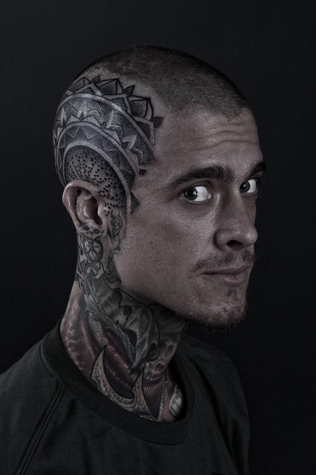 Here is tattoo artist Nathan Kostechko, tattooed by Hooper.