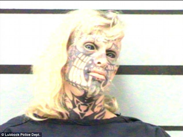 Tattooed Transsexual Poses For Terrifying Mugshot!!