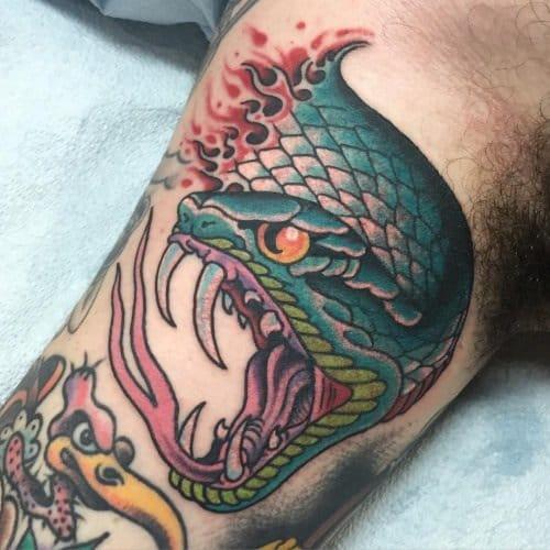 Severed animal head tattoo
