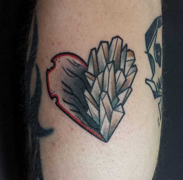 This heart tattoo magnificently merges two different tattoo styles. By Joscha Johnson. Instagram: @joscha_johnson.