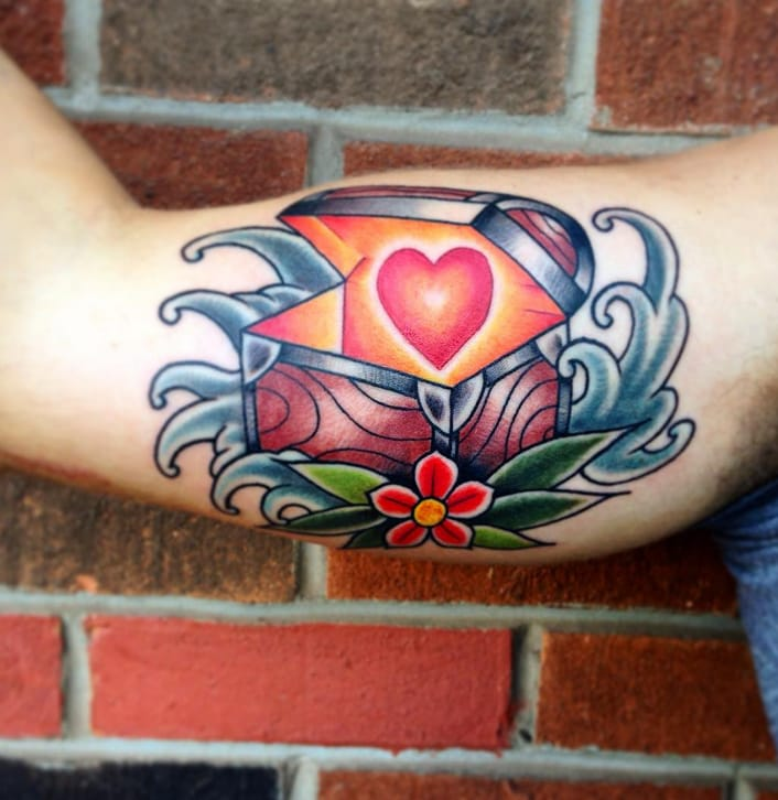 A bright, bold heart in a chest tattoo by Josh Jaehnig, Sacred Tattoo Studio, Marquette, Michigan, USA. Instagram: @joshjaehnig.