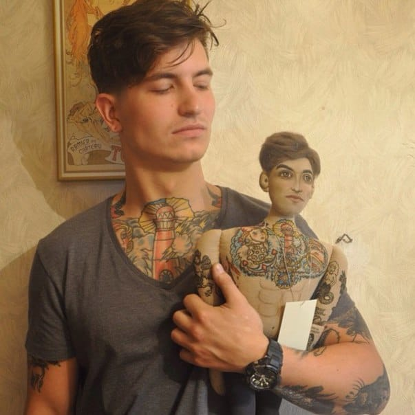 This guy looks just like his mini doll, check out the matching chest tattoo!