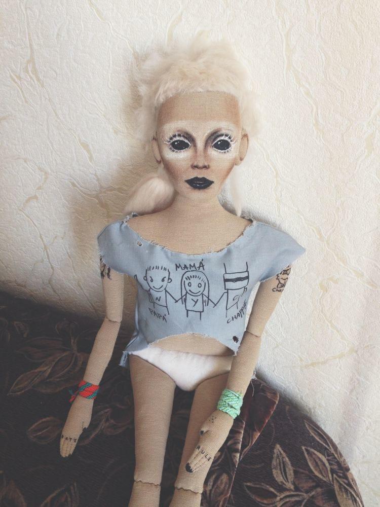 A female tattoo doll.