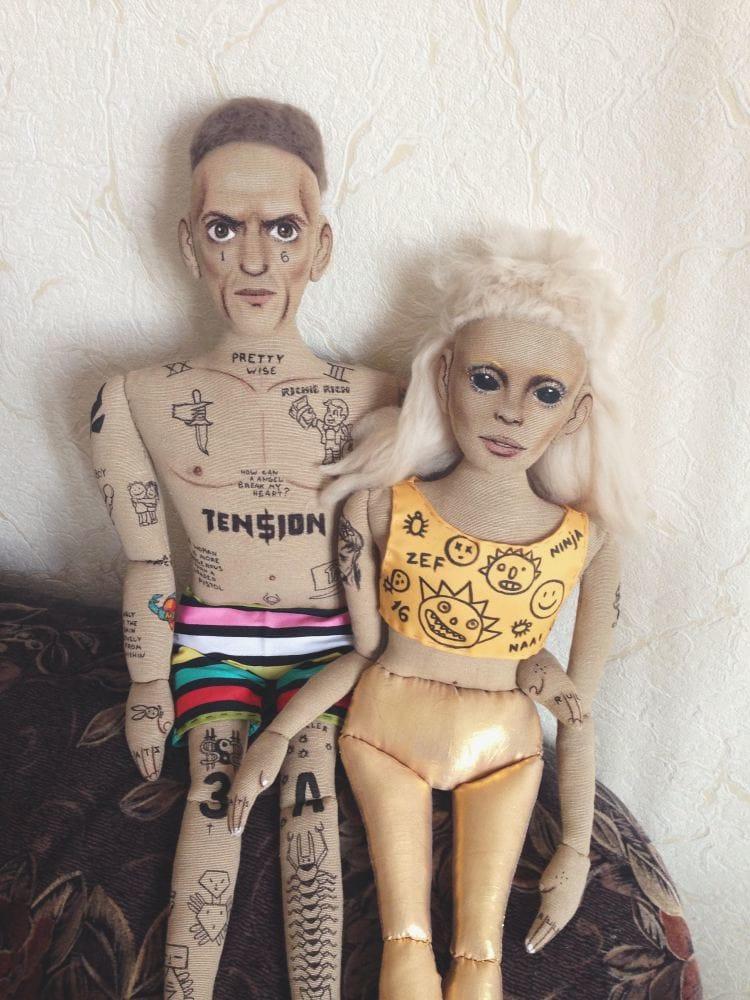 Tattooed couple by Kristina Tselykovskaya.