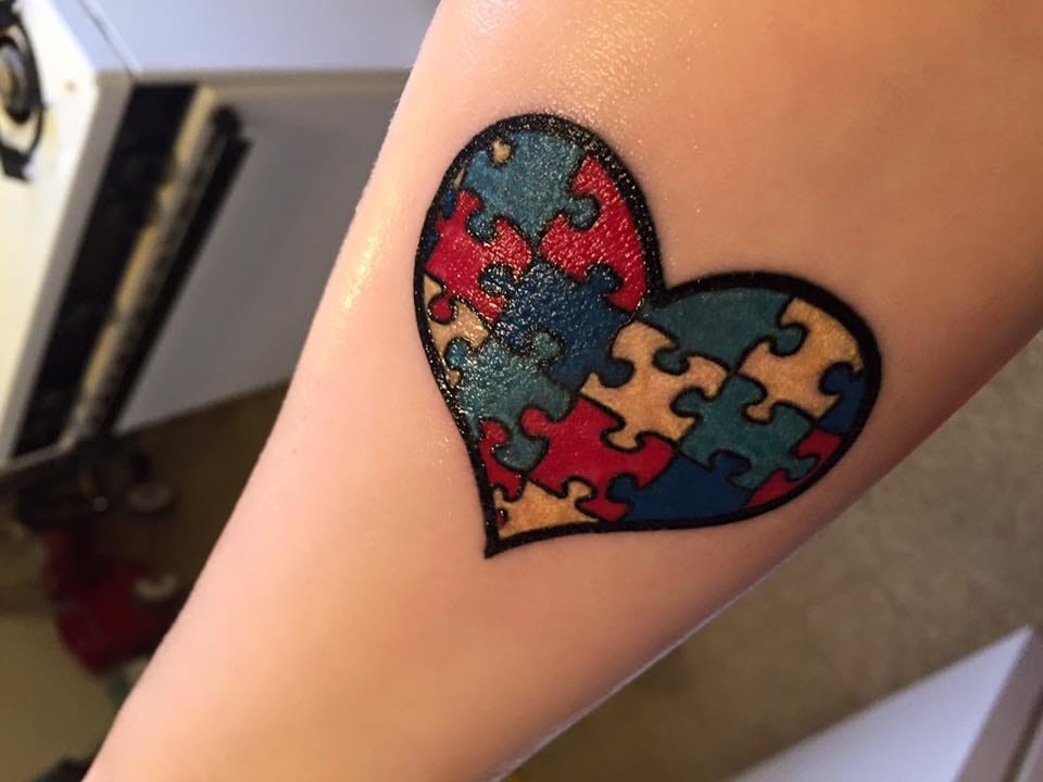 Autism inspired heart tattoo